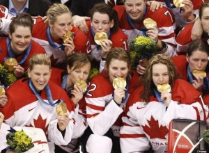 Team Canada pose after defeating the U.S. in the women's hockey gold medal game at the Vancouver 2010 Winter Olympics